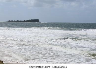 Surf beach Mudjimba, Sunshine Coast, Queensland, Australia.  High tide, rough seas.