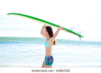Surf beautiful girl with green surfboard in beach shore