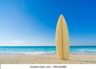 Surf board in the sand at the beach