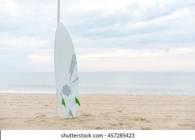 Surf board in the sand at the sunny beach