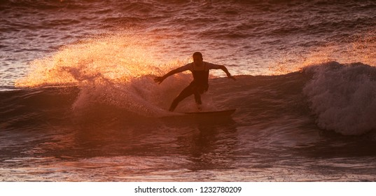 Surf boy athlete train and enjoy the power of the nature on the ocean waves do tricks. Youthful and happiness for alternative sport and lifestyle concept. Milennial people have fun