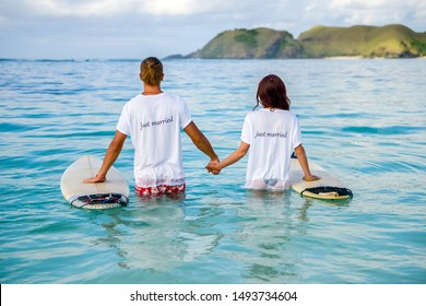 Surf couple surfing just married