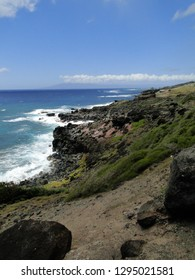 The surf crashes on the shore of Molokai
