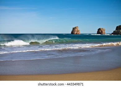 surf destination - breaking wave of atlantic ocean on sandy beach, hendaye, basque country, france