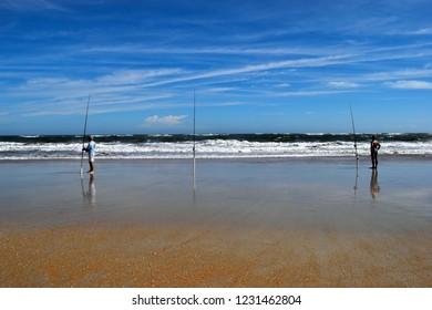 Surf Fishermen on the ocean beach at Florida, USA