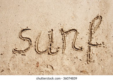 Surf handwritten in sand for natural, symbol,tourism or conceptual designs