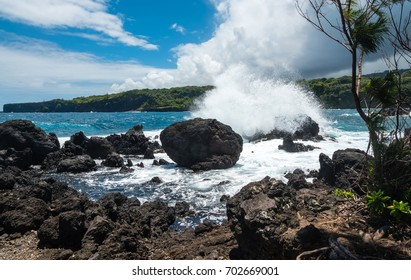 Surf hitting volcanic rocks at the Maui coastline