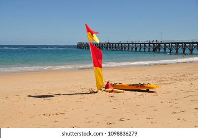 Surf lifesaving flag on the beach in Australia, Adelaide. Patrolled beach for water safety, swimming safety.