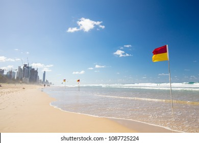 Surf lifesaving flags on a hot sunny day in Broadbeach, Gold Coast, Queensland, Australia