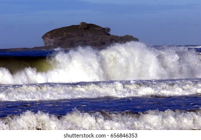 Surf with Mudjimba island, or Old Woman Island as it is nicknamed,  in the background
