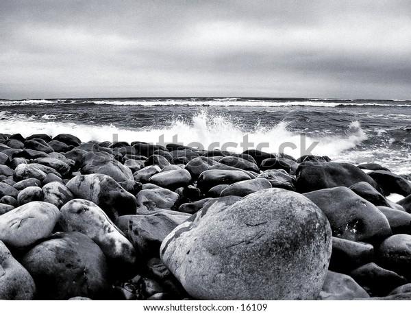 Surf spray over rocks.