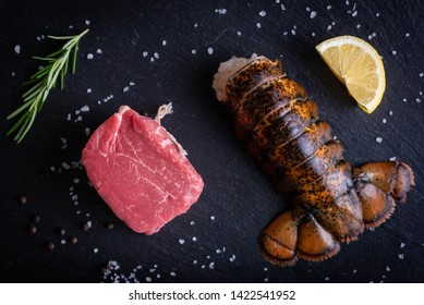surf and turf, raw fillet mignon and lobster tail