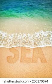 Surf wave on a inscription Sea on a beach