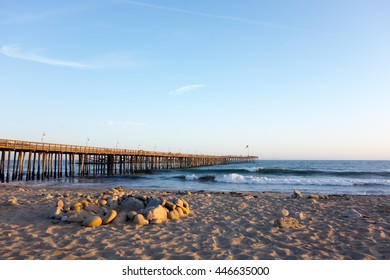 Surf waves near historic wooden pier in city of San Buena Ventura, Southern California