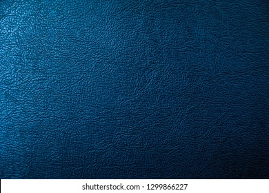 The surface of the black leather is Dark shaded by blue light. Embossed pattern for luxury decoration or input text.