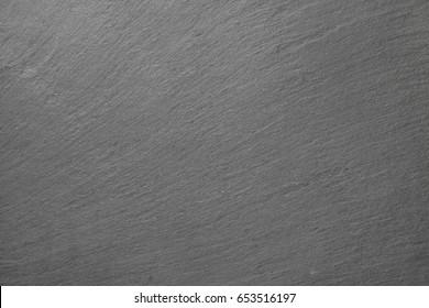 Surface of a black slate stone slab.