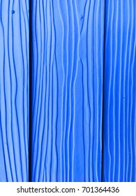 The surface of the blue wood wall.
