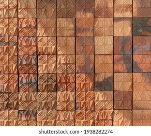 The surface of the brown terracotta panels that follow the exterior walls of the house, which was exposed to half the sunlight diagonally.