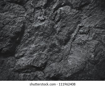 surface of the cave rock wall. gray stone texture background.