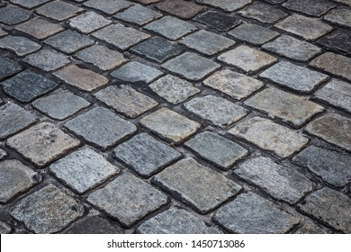 Surface detail of a cobblestone road.
