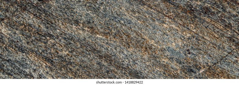 surface of fissured quartzite stone. Web banner for your design.