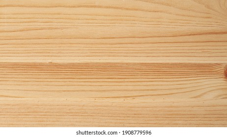 The surface of a fresh, planed pine Board close-up.