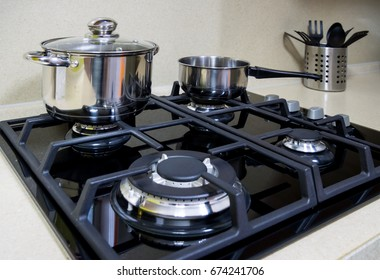 The surface of the gas cooker and the dishes standing on it