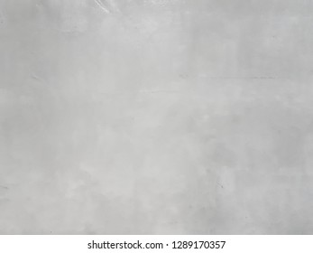 The surface of the gray plastered wall and polished to smooth, smooth and shiny. Abstract background.
