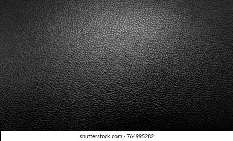 Surface of leatherette black color for textured background. On top view.