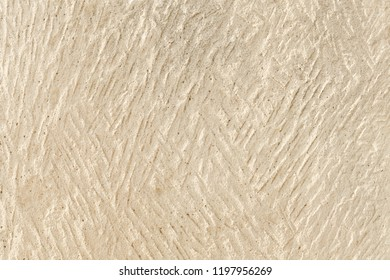 Surface of light Sandstone or shell rock with traces of rough manual processing. The background image, texture