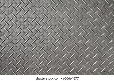 Surface of metal diamond steel plate background and texture.