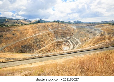 Surface mining of gold in an open pit mine in Waihi, New Zealand