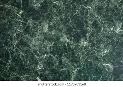 Surface of natural dark green marble texture with white veins. Natural green marble pattern. Marble background. Natural material