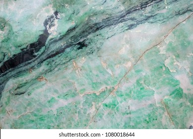 Surface of natural green Nephrite or jade stone, used as background with natural concept