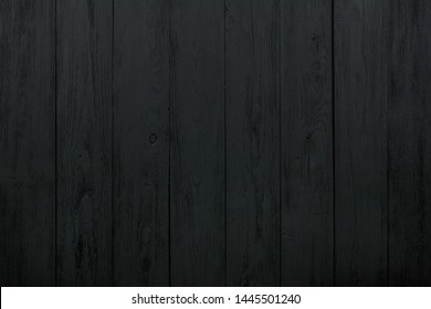 Surface from old, dark boards located a peak.