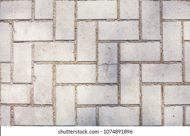 Surface Of Old Plastered Floor With White Geometrical Architecture Symmetrical bricks Or Diaper Repeated Pattern Vertical Background Texture Wallpaper.
