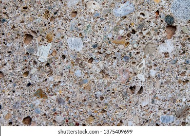 Surface of an old stone porous wall