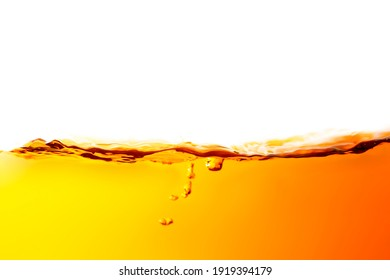 The surface of the orange water ripples looks like beer.