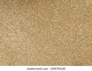 The surface of the park path is made of sand and tiny gravel. Texture of tiny gravel and sand. Tiny gravel texture on brown concrete wall.