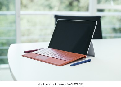 Surface pro tablet place on white table in meeting room