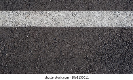 Surface rough of asphalt, Grey with white line on grainy road, Texture Background, Top view