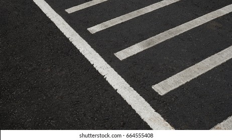 Surface rough of asphalt, Grey with white line on the road and small rock, Texture Background.