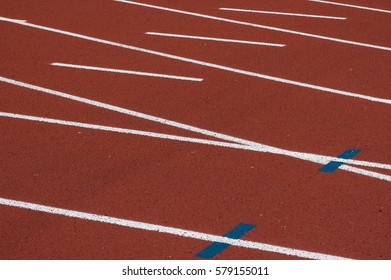 The surface of a running track.