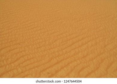 surface of sand dunes in Oman desert