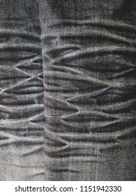 Surface of scratch on dark color denim jean