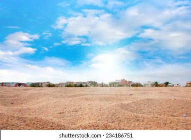 surface of the sea beach with a pile of sand and sky
