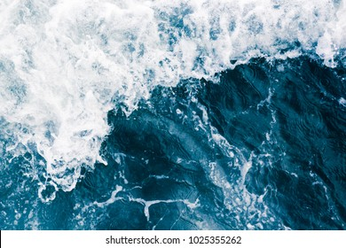 The surface of the sea with waves,  splash,  foam and bubbles, aqua abstract background
