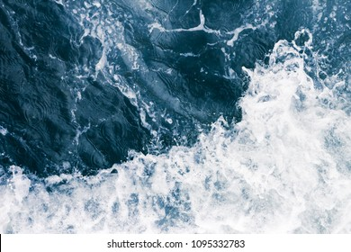 The surface of the sea  waves, splash,  foam and bubbles at high tide, aqua abstract background