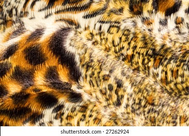 Surface of spotted, fake fur.