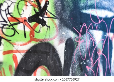 Surface of street wall with graffit - abstract colored drawings on walls of city